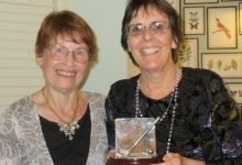 Acting Captain Sue presents Ann with a lovely trophy